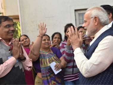 Prime Minister Narendra Modi meets voters at Ranip in Ahmedabad on 14 December, when Gujarat voted in the final phase of polls. (Twitter)