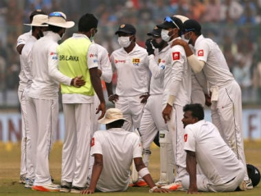 Sri Lankan players wearing anti-pollution masks during Day 2 of their third Test against India in Delhi. AP