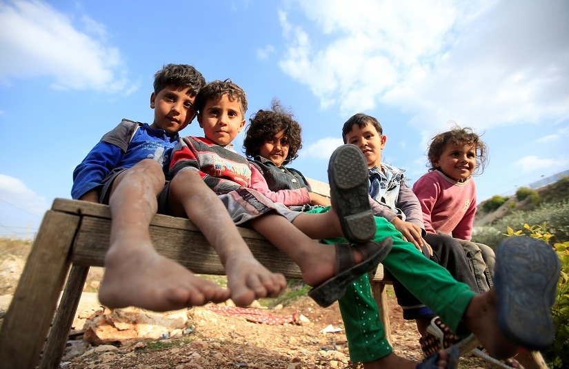Syrian refugee children sit together in Ain Baal village, near Tyre in southern Lebanon, November 27, 2017. Picture taken November 27, 2017. REUTERS/Ali Hashisho - RC1EB8B8DCB0