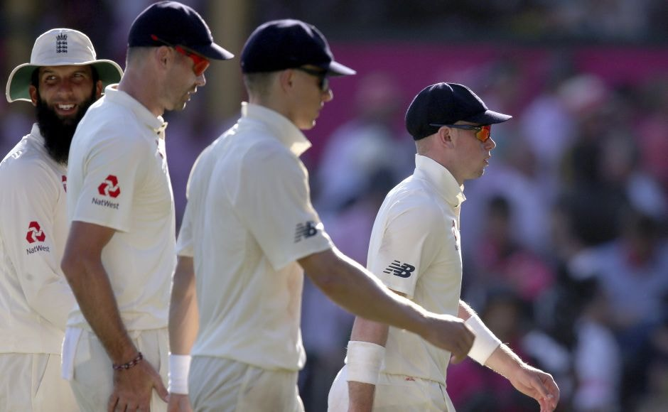 England players Mason Crane, right, Tom Curran, second right, James Anderson and Moeen Ali, left, walk off at stumps as England's stay in field doesn;t appear to be ending anytime soon. AP