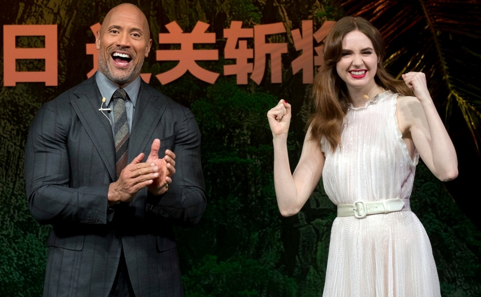 Dwayne Johnson and Karen Gillan laugh during the press conference for <em>Jumanji: Welcome to the Jungle</em>. AP/Mark Schiefelbein
