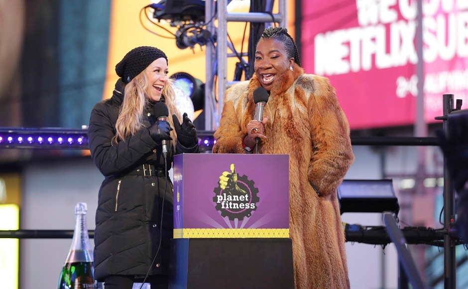 Television personality Allison Hagendorf (left) and activist Tarana Burke speak on stage at the New Year's Eve celebration in Times Square. AP/ Brent N Clarke