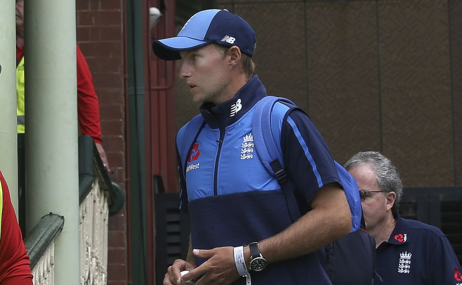 Joe Root arrives just as play begins on the last day of their Ashes Test match against Australia in Sydney. AP