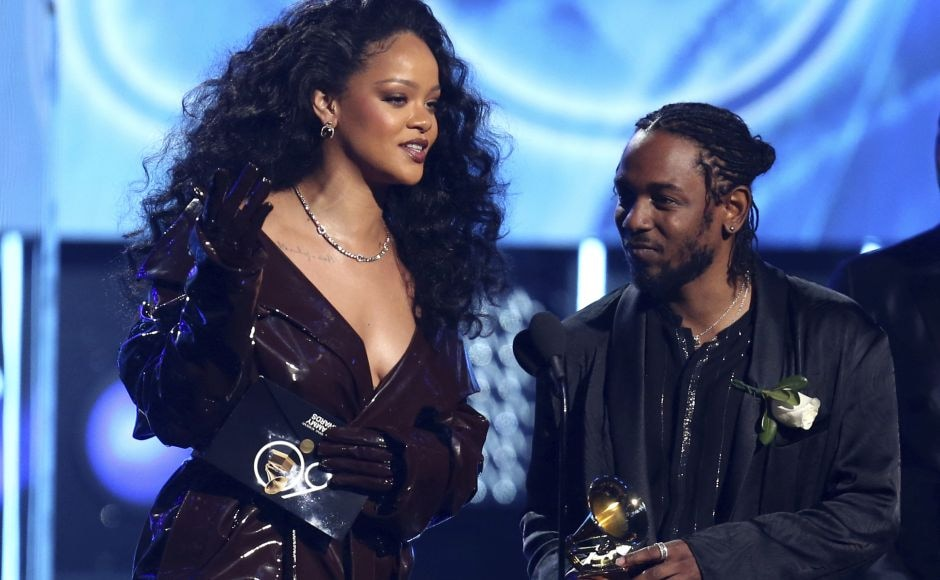 Rihanna(L) and Kendrick Lamar accept the award for best rap/sung performance for 'Loyalty.'AP