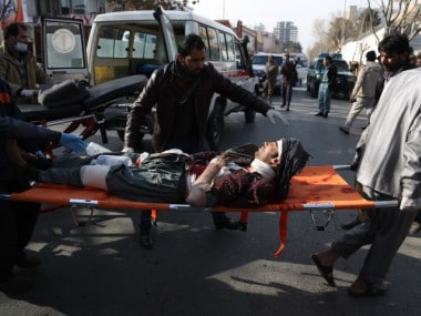 Afghanistan. An injured man is moved to a stretcher outside a hospital following a suicide attack in Kabul. AP