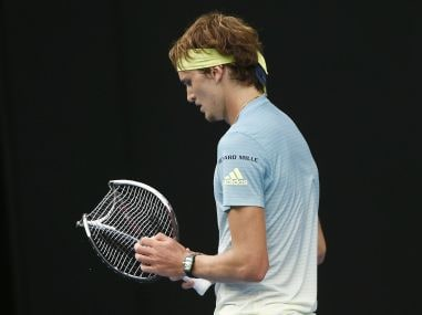 Alexander Zverev holds his broken racquet during his match against Chung Hyeon. Reuters
