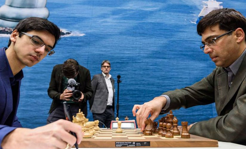 Anish Giri and Viswanathan Anand in action during Round 6 Image Courtesy: Alina L'ami