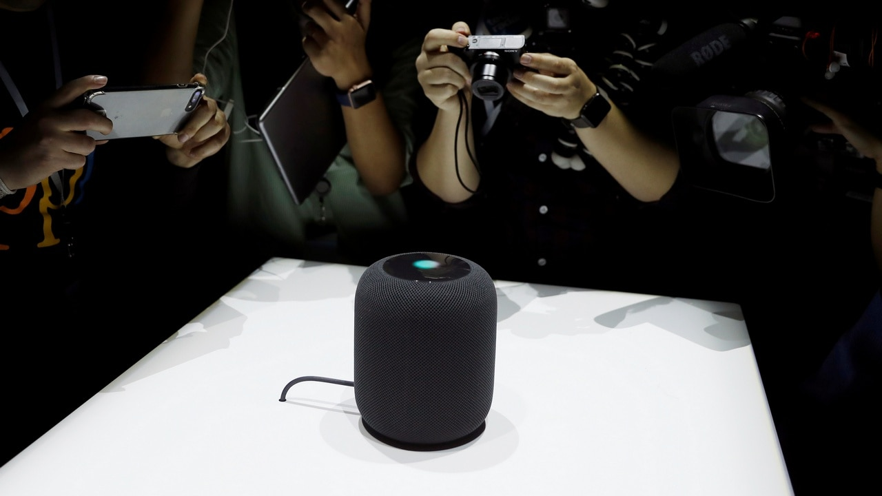 Members of the media photograph a prototype Apple HomePod. Image: Reuters