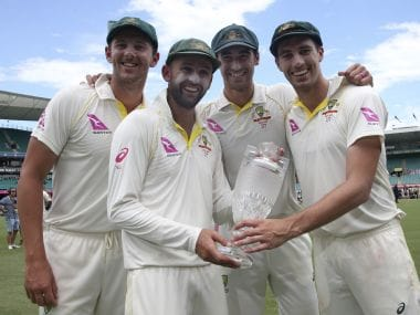 Australian bowlers Josh Hazlewood, left, Nathan Lyon, Mitchell Starc, second right, and Pat Cummins, right, hold the Ashes trophy as they celebrate at the end the last day of their Ashes Test match against England. AP