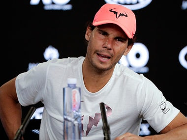 Spain's Rafael Nadal answers questions at a press conference after retiring injured from his Australian Open quarterfinal against Marin Cilic. AP