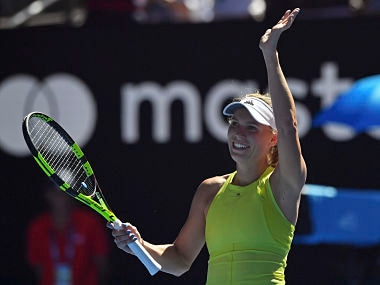 Denmark's Caroline Wozniacki reacts after defeating Croatia's Jana Fett during their second round match at the Australian Open tennis championships in Melbourne, Australia, Wednesday, Jan. 17, 2018. (AP Photo/Andy Brownbill)