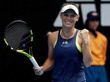 Denmark's Caroline Wozniacki celebrates after defeating Slovakia's Magdalena Rybarikova in their fourth round match at the Australian Open tennis championships in Melbourne, Australia Sunday, Jan. 21, 2018. (AP Photo/Dita Alangkara)