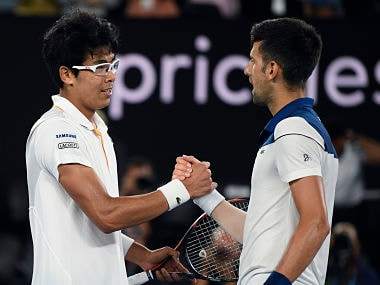 South Korea's Chung Hyeon, left, is congratulated by Serbia's Novak Djokovic after winning their fourth round match at the Australian Open tennis championships in Melbourne, Australia, Monday, Jan. 22, 2018. (AP Photo/Andy Brownbill)