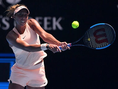 United States' Madison Keys hits a backhand return to France's Caroline Garcia during their fourth round match at the Australian Open tennis championships in Melbourne, Australia, Monday, Jan. 22, 2018. (AP Photo/Andy Brownbill)