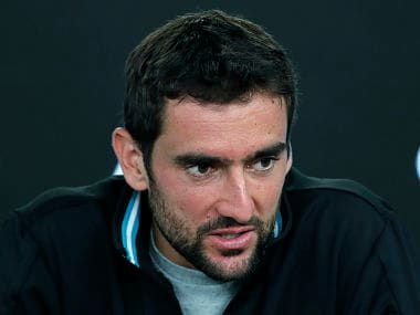 Croatia's Marin Cilic answers questions at a press conference following his loss to Switzerland's Roger Federer in the men's singles final at the Australian Open tennis championships in Melbourne, Australia, Monday, Jan. 29, 2018. (AP Photo/Vincent Thian)