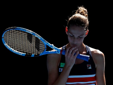 Karolina Pliskova of the Czech Republic waits to receive serve from Romania's Simona Halep during their quarterfinal at the Australian Open tennis championships in Melbourne, Australia, Wednesday, Jan. 24, 2018. (AP Photo/Ng Han Guan)