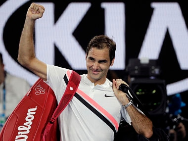 Switzerland's Roger Federer waves as he leaves Rod Laver Arena following South Korea's Hyeon Chung's retirement from their semifinal at the Australian Open tennis championships in Melbourne, Australia, Friday, Jan. 26, 2018. (AP Photo/Dita Alangkara)