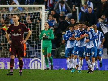 Espanyol's Oscar Melendo celebrates scoring their first goal with team mates as Barcelona's Thomas Vermaelen and Jasper Cillessen look dejected. Reuters