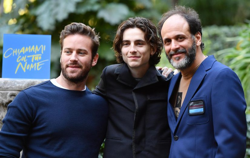 "US actors Timothee Chalamet, center, and Armie Hammer, left, pose with Italian director Luca Guadagnino, during the photocall for the movie ""Chiamami col tuo nome"" (Call Me by Your Name) in Rome, Italy, Wednesday, Jan. 24, 2018. (Ettore Ferrari/ANSA via AP)"