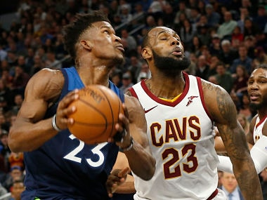 Minnesota Timberwolves' Jimmy Butler, left, drives past Cleveland Cavaliers' LeBron James in the first half of an NBA basketball game Monday, Jan. 8, 2018, in Minneapolis. (AP Photo/Jim Mone)