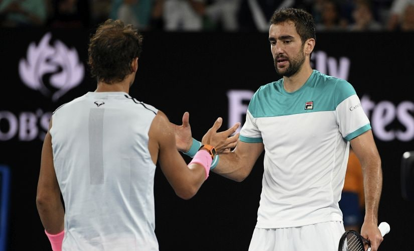 Spain's Rafael Nadal, left, is consoled by Croatia's Marin Cilic after he retired injured from their quarterfinal. AP