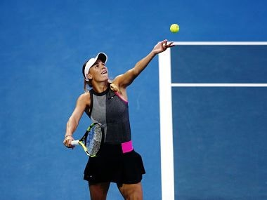 Caroline Wozniacki in action against Madison Brengle in her first round match. Image courtesy: Twitter @WTA