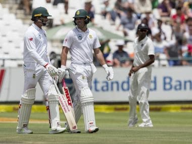 Injured South African Dale Steyn, left, talks to AB de Villiers before taking to the crease on the fourth day of the first Test between South Africa and India. AP