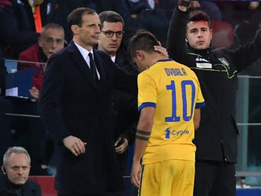 Juventus' Paulo Dybala is hugged by coach Massimiliano Allegri as he is substituted after sustaining an injury. Reuters