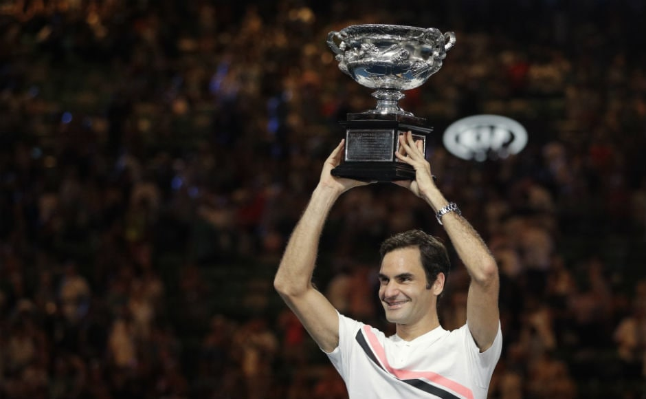 Switzerland's Roger Federer holds his trophy aloft after defeating Croatia's Marin Cilic. AP