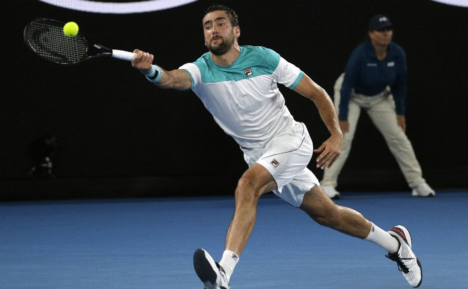 Marin Cilic runs to make a forehand return to Switzerland's Roger Federer in opening set of the men's singles final. AP