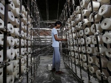 An employee works at a textile mill in Meerut
