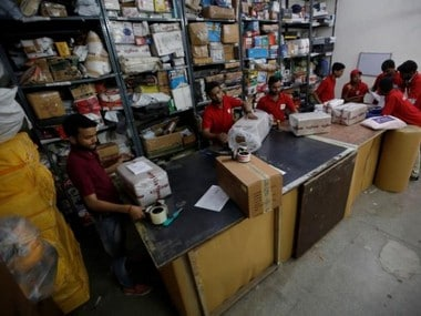 Employees sort packages at a Moglix distribution center warehouse in New Delhi