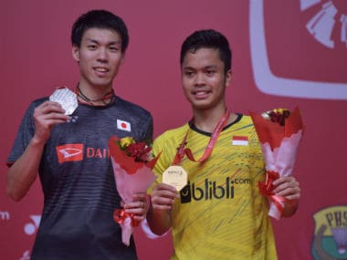 Anthony Sinisuka Ginting of Indonesia (R) poses with his gold medal on the podium with runner-up Kazumasa Sakai of Japan following their men's singles final during the Indonesia Masters. AFP