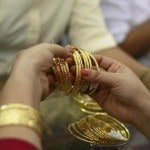 Gold prices jump Rs 230 to Rs 34,680 per 10 gram on positive global cues; slow local demand caps gains