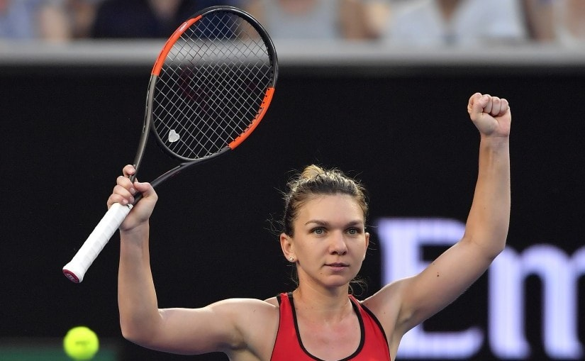 Simona Halep celebrates after defeating Eugenie Bouchard in their second round match at the Australian Open. AP