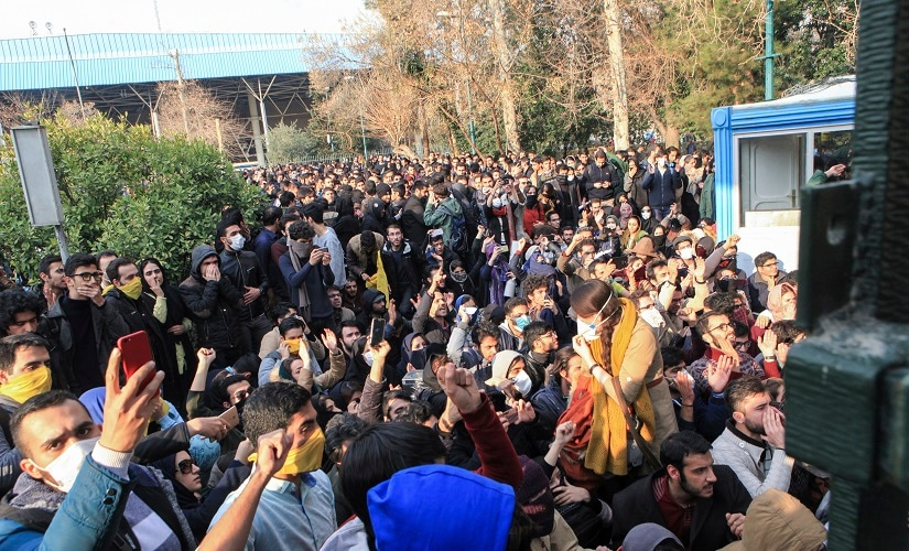 University students attend a protest inside Tehran University while anti-riot Iranian police prevent them to join other protestors. AP