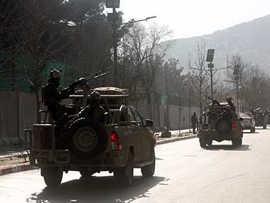Security forces are driven to the site of a suicide attack in the center of Kabul, Afghanistan. AP