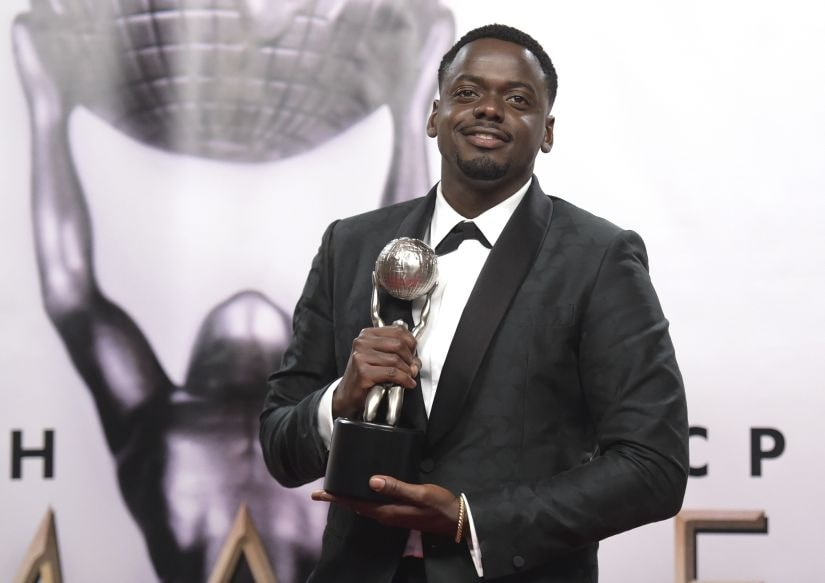 """Daniel Kaluuya poses in the press room with the award for outstanding actor in a motion picture for """"Get Out"""" at the 49th annual NAACP Image Awards at the Pasadena Civic Auditorium on Monday, Jan. 15, 2018, in Pasadena, Calif. (Photo by Richard Shotwell/Invision/AP)"""