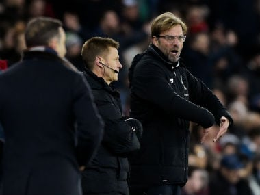 Liverpool manager Jurgen Klopp talks to the fourth official on the touchline. Reuters
