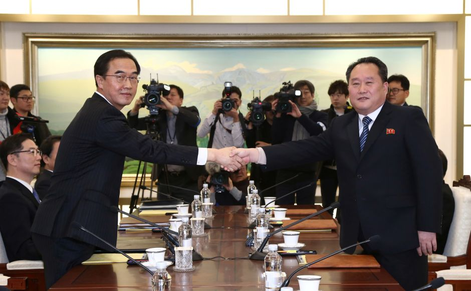 Ri Son Gwon shakes hands with his South Korean counterpart Cho Myoung-gyon during their meeting at the truce village of Panmunjom where North Korea announced it will send it will send a delegation of high-ranking officials, athletes and a cheering squad to the Pyeongchang Winter Olympics in South Korea next month. Reuters