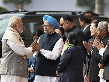 File image of Narendra Modi and Manmohan Singh. PTI
