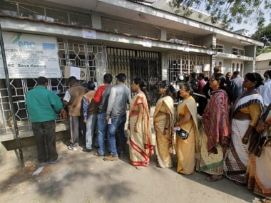 People queue outside NRC Seva Kendra to check names of themselves and family members in a draft for National Register of Citizens (NRC) in Guwahati on Monday.  PTI