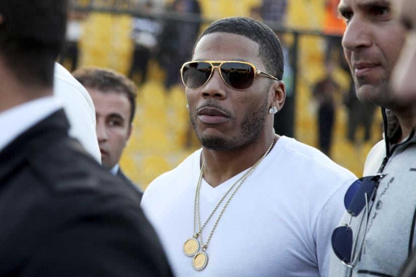 """FILE- In this March 13, 2015 file photo, rapper Nelly approaches the stage for a concert in Irbil, northern Iraq. A woman who alleges the rapper Nelly raped her on his tour bus after a performance in Seattle says he sexually assaulted two other women in England. Attorney Scott Rosenblum said Saturday, Jan. 27, 2018 in an email that the allegations are """"completely fabricated"""" and the lawsuit is a """"money grab."""" The amended complaint filed Jan. 22 in a Seattle court does not list the women by name. (AP Photo/Seivan M. Salim, File)"""