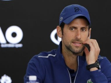 Novak Djokovic gestures during a press conference at the Australian Open. AP
