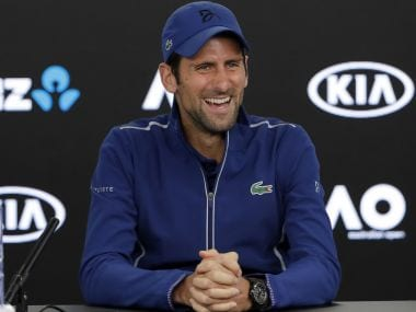 Novak Djokovic smiles during a press conference at the Australian Open. AP