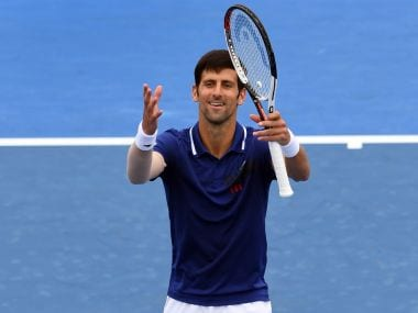 Novak Djokovic waves to the crowds after winning his match against Dominic Thiem. AFP
