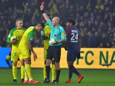Nantes defender Diego Carlos (centre) receives a red card during the match against Paris Saint-Germain. AFP