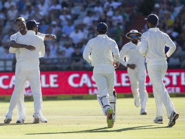 Hardik Pandya celebrating with his teammates after taking the wicket of Dean Elgar. AP