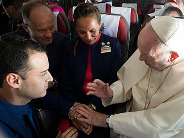 Pope Francis marries flight attendants Carlos Ciuffardi, left, and Paola Podest, center, during a flight from Santiago, Chile, to Iquique, Chile. AP