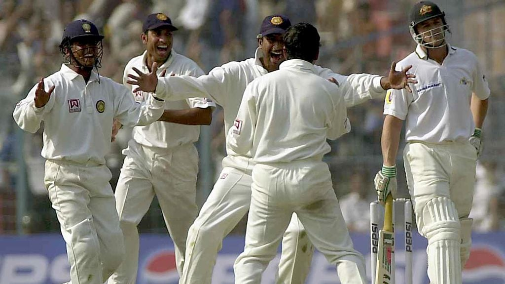 India's Sadagoppan Ramesh (C) congratulates team-mate Sachin Tendulkar (back to the camera) with open arms as fellow teammates join in the celebrations after Tendulkar claimed the wicket of Australian batsman Adam Gilchrist (R) on the fifth day of the second test match between India and Australia at Eden Gardens in Calcutta 15 March 2001. Australia were in trouble at 191 for 9 after India set a 384 runs victory target for Australia. AFP PHOTO